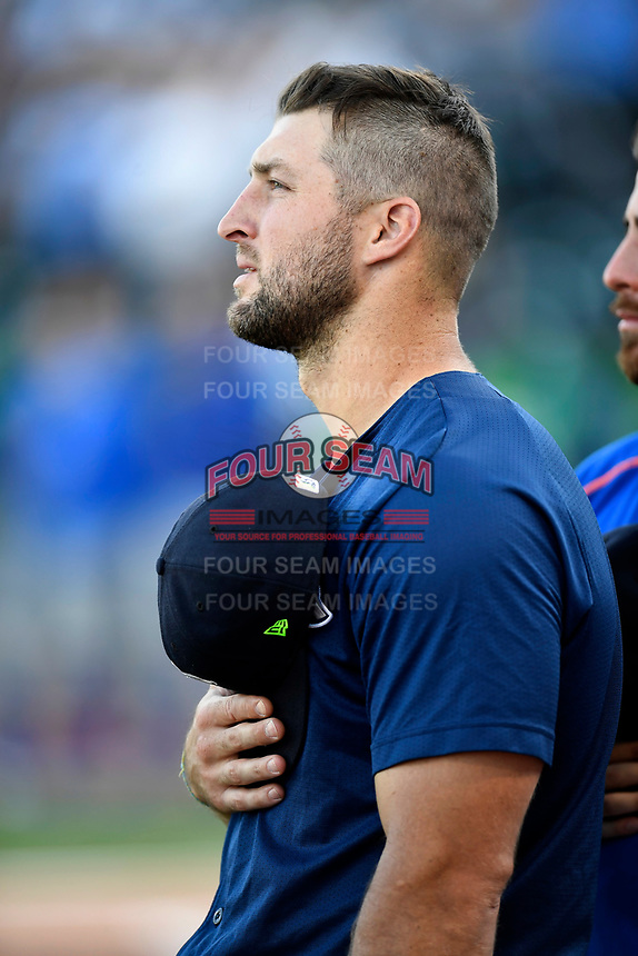 Designated hitter Tim Tebow (15) of the Columbia Fireflies listens to the National Anthem before a game against the Lexington Legends on Thursday, June 8, 2017, at Spirit Communications Park in Columbia, South Carolina. Columbia won, 8-0. (Tom Priddy/Four Seam Images)