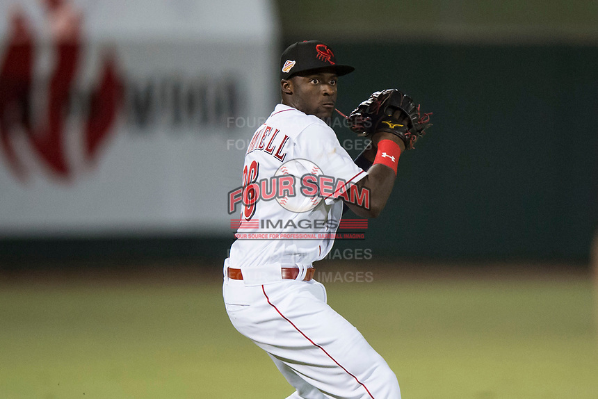 Scottsdale Scorpions left fielder Taylor Trammell (26), of the Cincinnati Reds organization, prepares to make a throw to the infield during an Arizona Fall League game against the Mesa Solar Sox on October 9, 2018 at Scottsdale Stadium in Scottsdale, Arizona. The Solar Sox defeated the Scorpions 4-3. (Zachary Lucy/Four Seam Images)
