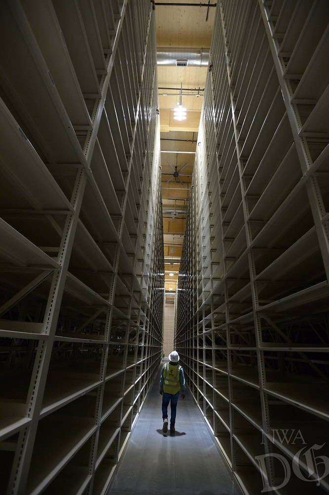 NWA Democrat-Gazette/ANDY SHUPE<br /> Palash Shah, a project engineer for Con-Real, leads a tour Friday, June 29, 2018, of a storage facility being constructed by the University of Arkansas for the storage of library materials south of Martin Luther King Jr. Boulevard in Fayetteville. The proper place for books in a space-starved library at the University of Arkansas, Fayetteville has become the subject of some debate after an email sent to faculty by an outgoing librarian urging them to fight against changes that are removing roughly two-thirds of printed materials.