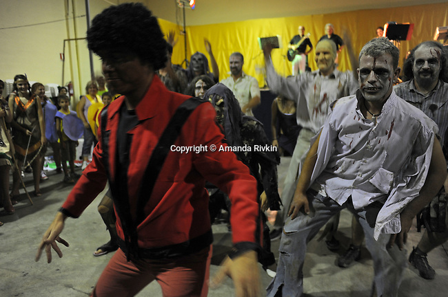 "The first place winners dressed as Michael Jackson and the zombies in his ""Thriller"" video dance upon being named the winners of Costume Night celebration during the municipal fiestas in Costur, Spain on August 17, 2009."