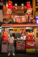 Takoyaki Restaurant in Dotombori - pleasure district famous for its historic theaters, its shops and restaurants and its many neon and mechanized signs, including demons, moving giant crabs and other dramatic kitsch.