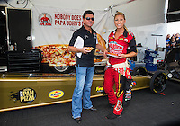 Oct 15, 2016; Ennis, TX, USA; NHRA top fuel driver Leah Pritchett andPapa Johns Pizza owner John Schnatter during qualifying for the Fall Nationals at Texas Motorplex. Mandatory Credit: Mark J. Rebilas-USA TODAY Sports