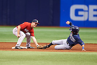 Boston Red Sox Chad De La Guerra (7) tags Peter Maris sliding into second during an instructional league game against the Tampa Bay Rays on September 24, 2015 at Tropicana Field in St Petersburg, Florida.  (Mike Janes/Four Seam Images)