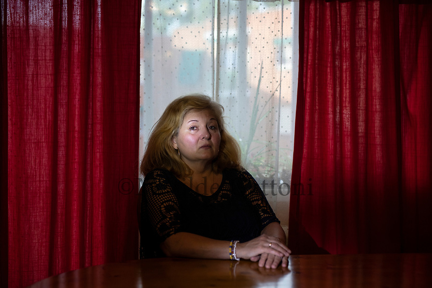 """Spain - Collado Villalba - Portrait of Cristina Moracho Martin, 52. In the evening of the 14th of May 1984, Cristina Moracho Martin was alone at home in Collado Villalba, a small village on the outskirts of Madrid, together with her 15-month-daughter Jesica. Moracho was 17, and 7-month-pregnant of her second baby. The contractions started suddenly. """"Moments later I broke water, and my son was born"""", she recounts. Unable to notify her husband - the house didn't have a telephone - Moracho cut the umbilical cordon herself and tied it with a sewing thread. After leaving her newborn in bed beside her daughter, she went out to seek help.When the medical first aid arrived the mother was in danger - she had bled profusely - but the baby looked fine. Both were put on an ambulance and brought to the Hospital Clínico San Carlos.""""I heard him crying and moving all the way to Madrid. He was full of energy"""", continues Moracho, who never saw her child again. He apparently died at the hospital, while his mother was having the placenta removed. Despite several requests, the family couldn't see the corpse and was never told in which cemetery the body had been buried."""