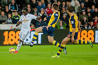 Sunday 9th November 2014<br /> Pictured: Marvin Emnes of Swansea City crosses the ball <br /> Re: Barclays Premier League Swansea City v Arsenal at the Liberty Stadium, Swansea, Wales,UK