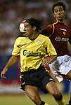 3 August 2004: Milan Baros (left) tries to get the ball off of his shoulder before Cristian Panucci (right) does. Liverpool of the English Premier League defeated AS Roma of Italy's La Liga 2-1 at Giants Stadium in the Meadowlands Complex in East Rutherford, NJ in a ChampionsWorld Series friendly match..