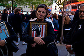 New York, New York<br /> September 11, 2010<br /> <br /> Anna Sereno holds a photo of her son Arturo Angelo Sereno, as friends and relatives of the victims of the Sept. 11, 2001 attacks gather for a commemoration ceremony at Zuccotti Park, adjacent to ground zero, on the ninth anniversary of the terrorist attacks on the World Trade Center, Saturday, Sept. 11, 2010.<br /> <br /> Visible progress is finally being made toward rebuilding the World Trade Center site known as Ground Zero. Delays from political, security and financing concerns have dominated the public image of the roughly $11 billion project in the absence of a gleaming new skyscraper or memorial to those who died when al Qaeda hijackers destroyed the Twin Towers.