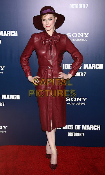 "Evan Rachel Wood.The New York Premiere of ""The Ides of March"" at the Ziegfeld Theater, New York, NY, USA..October 5th, 2011.full length red maroon burgundy leather hat jacket purple lipstick hands on hips jacket dress pussybow .CAP/LNC/TOM.©TOM/LNC/Capital Pictures."