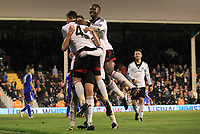 Moussa Dembele and Liam Donnelly jump on the back of goalscorer, Emerson Hyndman, to celebrate Fulham's third goal