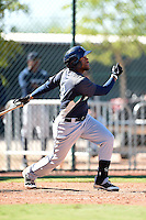 Seattle Mariners infielder Gianfranco Wawoe (10) during an Instructional League game against the Cleveland Indians on October 1, 2014 at Goodyear Training Complex in Goodyear, Arizona.  (Mike Janes/Four Seam Images)