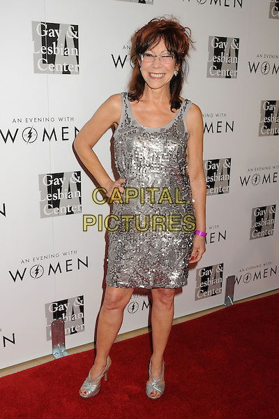 "Mindy Sterling.LA Gay & Lesbian Center's ""An Evening With Women"" 2013 held at the Beverly Hilton Hotel, Beverly Hills, California, USA, 18th May 2013..full length silver dress hand on hip sequined sequin glasses .CAP/ADM/BP.©Byron Purvis/AdMedia/Capital Pictures"