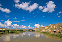 Badlands  and clouds reflected in the South Saskatchewan River off Hwy 41<br />