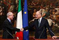 Il Presidente del Consiglio Enrico Letta stringe la mano al Presidente del Consiglio Europeo Herman Van Rompuy, sinistra, al termine della conferenza stampa congiunta a Palazzo Chigi,  Roma, 4 dicembre 2013.<br /> Italian Premier Enrico Letta shakes hands with EU Council President Herman Van Rompuy, left, at the end of their press conference at Chigi Palace, Rome, 4 December 2013.<br /> UPDATE IMAGES PRESS/Isabella Bonotto