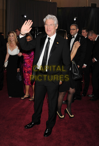 Richard Gere.85th Annual Academy Awards held at the Dolby Theatre at Hollywood & Highland Center, Hollywood, California, USA..February 24th, 2013.oscars full length white shirt black suit tie glasses hand in pocket arm palm waving .CAP/ROT/TM.©Tony Michaels/Roth Stock/Capital Pictures