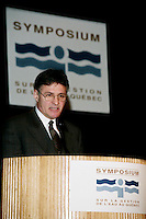 Montreal (Qc) CANADA - December 12, 1997<br /> -File Photo -<br /> Paul Begin, quebec environment Minister speak at Sympeau - symposium sur l'eau held at Montreal Convention Centre.<br /> <br /> <br /> Paul Begin (born May 15, 1943 in Dolbeau, Quebec) is a former Quebec politician and Cabinet Minister. Member of the Parti Qu&eacute;becois, he served as the province's Justice Minister from 1994 to 1997 and from 2001 to 2002. Louis-H&eacute;bert riding in the 1994 elections when the Parti Qu&eacute;becois re-claimed power after 9 years of Liberal governance under Robert Bourassa and Daniel Johnson Jr.. During his political career, he was also a member of Cabinet, being first named for the first time as Justice Minister in the Jacques Parizeau (and later Lucien Bouchard)Cabinet from 1994 to 1997. He was also the Environment Minister from 1997 to 2001, Minister of Wildlife from 1997 to 1998 and Minister of Revenue from 1999 to 2001 before being re-named as Justice Minister in the Bernard Landry Cabinet for his final year until he sat as an Independent MNA in 2002. He did not seek a third mandate in the 2003 elections.