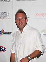 Aug. 29, 2013; Avon, IN, USA: NHRA top fuel dragster driver Tommy Johnson Jr on the red carpet prior to the premiere of Snake & Mongoo$e at the Regal Shiloh Crossing Stadium 18. Mandatory Credit: Mark J. Rebilas-