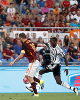 Calcio, Serie A: Roma vs Juventus. Roma, stadio Olimpico, 30 agosto 2015.<br /> Juventus&rsquo; Paul Pogba, right, is challenged by Roma&rsquo;s Daniele De Rossi during the Italian Serie A football match between Roma and Juventus at Rome's Olympic stadium, 30 August 2015.<br /> UPDATE IMAGES PRESS/Isabella Bonotto