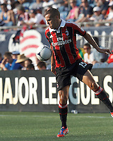 AC Milan substitute defender Djamel Mesbah (15) traps the ball. In an international friendly, AC Milan defeated C.D. Olimpia, 3-1, at Gillette Stadium on August 4, 2012.