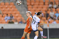 Houston, TX - Saturday July 08, 2017: Janine van Wyk heads the ball away from Hayley Raso during a regular season National Women's Soccer League (NWSL) match between the Houston Dash and the Portland Thorns FC at BBVA Compass Stadium.