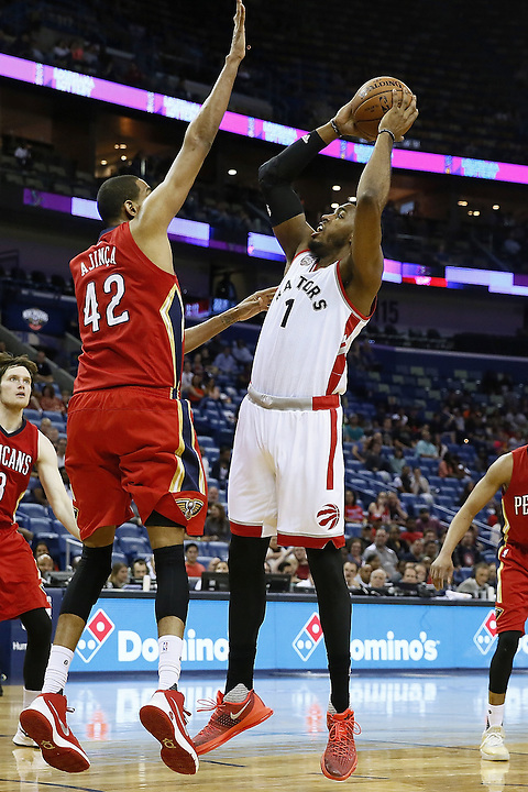 NEW ORLEANS, LA - MARCH 26: Jason Thompson #1 of the Toronto Raptors shoots over Alexis Ajinca #42 of the New Orleans Pelicans during a game at the Smoothie King Center on March 26, 2016 in New Orleans, Louisiana. NOTE TO USER: User expressly acknowledges and agrees that, by downloading and or using this photograph, User is consenting to the terms and conditions of the Getty Images License Agreement.  (Photo by Jonathan Bachman/Getty Images)