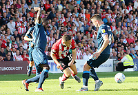 Lincoln City's Jack Payne goes down under the challenge from Bristol Rovers' Abu Ogogo<br /> <br /> Photographer Rich Linley/CameraSport<br /> <br /> The EFL Sky Bet League One - Lincoln City v Bristol Rovers - Saturday September 14th 2019 - Sincil Bank - Lincoln<br /> <br /> World Copyright © 2019 CameraSport. All rights reserved. 43 Linden Ave. Countesthorpe. Leicester. England. LE8 5PG - Tel: +44 (0) 116 277 4147 - admin@camerasport.com - www.camerasport.com