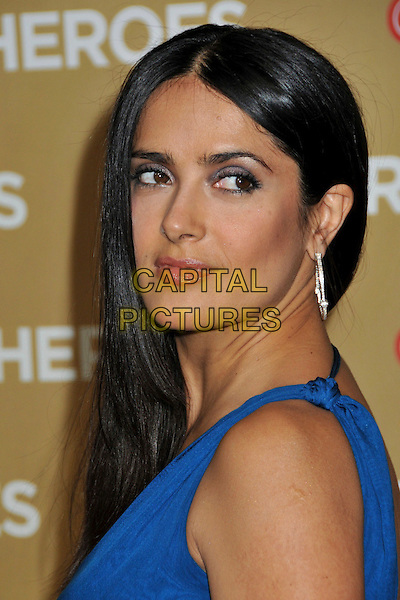 SALMA HAYEK .at The CNN Heroes: An All Star Tribute held at The Kodak Theatre in Hollywood, California, USA, November 22nd 2008.                                                                  .portrait headshot straight hair blue silver hoop earrings over shoulder .CAP/ADM/BP.©Byron Purvis/Admedia/Capital PIctures
