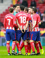 Atletico de Madrid's players have words with the referee Jose Luis Munuera Montero during La Liga match. January 6,2018. (ALTERPHOTOS/Acero) /NortePhoto.com NORTEPHOTOMEXICO