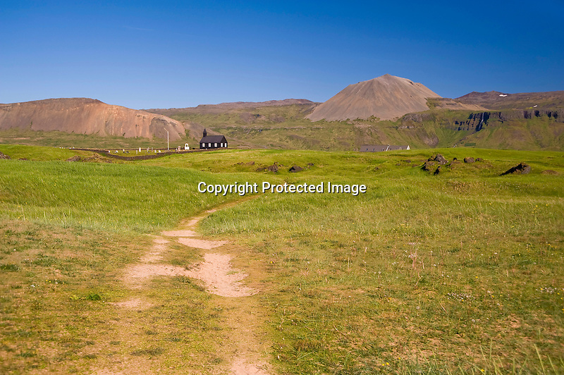 View of Budir Church and Cemetery and Budaklettur Crater in West Iceland