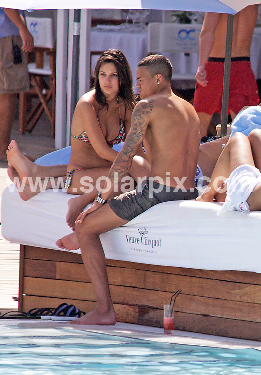 **ALL ROUND EXCLUSIVE PICTURES FROM SOLARPIX.COM**.**WORLDWIDE SYNDICATION RIGHTS**.Tottenham and England football hotshot Jermaine Jenas spent the day at The Ocean Club in Marbella, with his girlfriend or is his fiance ?. That is a very large diamond ring on her left hand ? The couple looked madly in love and couldn't keep their hands off each other as he swigged beer and joked with friends...JOB REF:   9221   AB1       DATE:  12.06.09.**MUST CREDIT SOLARPIX.COM OR DOUBLE FEE WILL BE CHARGED**.**ONLINE USAGE FEE GBP 50.00 PER PICTURE - NOTIFICATION OF USAGE TO PHOTO @ SOLARPIX.COM**.**CALL SOLARPIX : +34 952 811 768 or LOW RATE FROM UK 0844 617 7637**