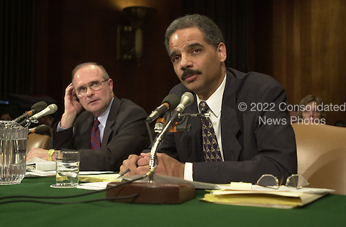 Roger Adams, left, pardon attorney, United States Department of Justice and Eric Holder, right, former Deputy Attorney General, testify before the U.S. Senate Judiciary Committee on the pardon of Marc Rich on February 14, 2001 in Washington, D.C..Credit: Ron Sachs / CNP