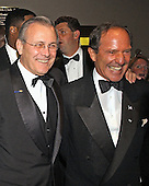 United States Secretary of Defense Donald Rumsfeld and Publisher Mort Zuckerman at the 2002  White House Correspondent's Dinner at the Washington Hilton Hotel in Washington, DC on May 4, 2002.<br /> Credit: Ron Sachs / CNP