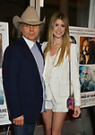 """Dwight Yoakam, Emily Joyce 044 attends the Premiere Of Sony Pictures Classic's """"David Crosby: Remember My Name"""" at Linwood Dunn Theater on July 18, 2019 in Los Angeles, California."""