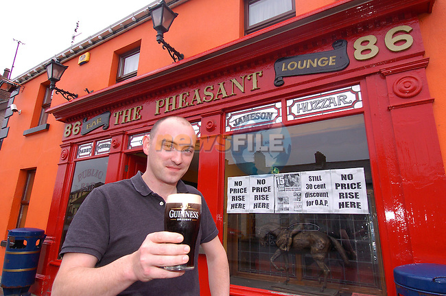 Gerry Brady with his pint of Guinness outside his pub in Drogheda..Photo Fran Caffrey Newsfile.ie..This Picture has been sent to you by Newsfile Ltd..The Studio,.Millmount Abbey,.Drogheda,.Co. Meath,.Ireland..Tel: +353(0)41-9871240.Fax: +353(0)41-9871260.ISDN: +353(0)41-9871010.www.newsfile.ie..general email: pictures@newsfile.ie