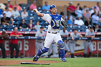 Durham Bulls catcher Luke Maile (26) makes a throw to first base against the Indianapolis Indians at Durham Bulls Athletic Park on August 4, 2015 in Durham, North Carolina.  The Indians defeated the Bulls 5-1.  (Brian Westerholt/Four Seam Images)