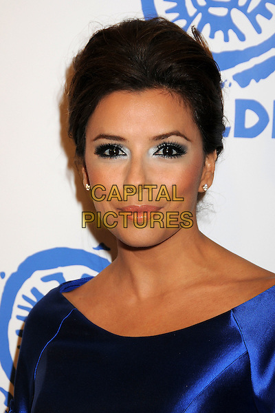 EVA LONGORIA PARKER.At MALDEF's 35th Annual Los Angeles Awards Gala held at the Westin Bonaventure Hotel, Los Angeles, California, USA, 12th November 2009..portrait headshot hair up blue silk satin silver eyeshadow make-up eye contact .CAP/ADM/BP.©Byron Purvis/AdMedia/Capital Pictures.