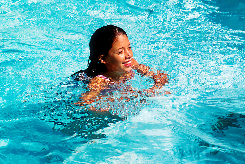 Smiling young girl in a swimming pool.