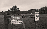 Signage at the entrance to Scatter Creek Wildlife Area with the Miller-Brewer barn in the background.  Rochester, Washington.