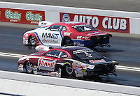 Feb. 17, 2013; Pomona, CA, USA; NHRA pro stock driver Greg Stanfield (far lane) races alongside Greg Anderson during the Winternationals at Auto Club Raceway at Pomona. Mandatory Credit: Mark J. Rebilas-