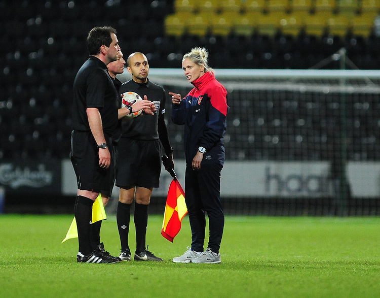 Arsenal Ladies' Manager Shelley Kerr, right, speaks to Referee Darren Russell at the end of the game<br /> <br /> Photo by Chris Vaughan/CameraSport<br /> <br /> Women's Football - FA Women&rsquo;s Super League 1 - Notts County Ladies v Arsenal Ladies - Wednesday 16th April 2014 - Meadow Lane - Nottingham<br /> <br /> &copy; CameraSport - 43 Linden Ave. Countesthorpe. Leicester. England. LE8 5PG - Tel: +44 (0) 116 277 4147 - admin@camerasport.com - www.camerasport.com