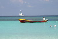 Water taxis are just one way to get around on Roatan's West Bay beach area.
