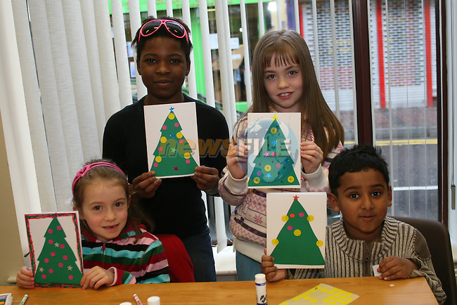Aifric Kydon, Precious Ojo, Linda Mackle and Milan Simi Surmant at the Children's Christmas Card Creation Workshop in Drogheda Library...Photo NEWSFILE/Jenny Matthews.(Photo credit should read Jenny Matthews/NEWSFILE)....This Picture has been sent you under the condtions enclosed by:.Newsfile Ltd..The Studio,.Millmount Abbey,.Drogheda,.Co Meath..Ireland..Tel: +353(0)41-9871240.Fax: +353(0)41-9871260.GSM: +353(0)86-2500958.email: pictures@newsfile.ie.www.newsfile.ie.FTP: 193.120.102.198.