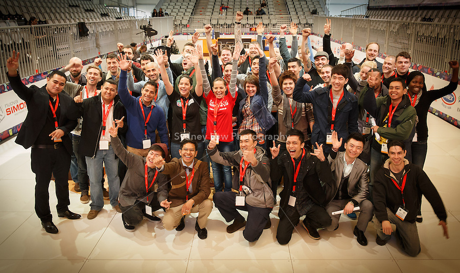 MELBOURNE, AUSTRALIA - MAY 22: Competitors in the 2013 World Barista Championship pose for a group photograph at the Melbourne Showgrounds, Australia. Photo Sydney Low / syd-low.com