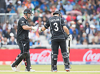 Colin de Grandhomme (New Zealand) congratulates Ross Taylor (New Zealand) on his half century during India vs New Zealand, ICC World Cup Semi-Final Cricket at Old Trafford on 9th July 2019