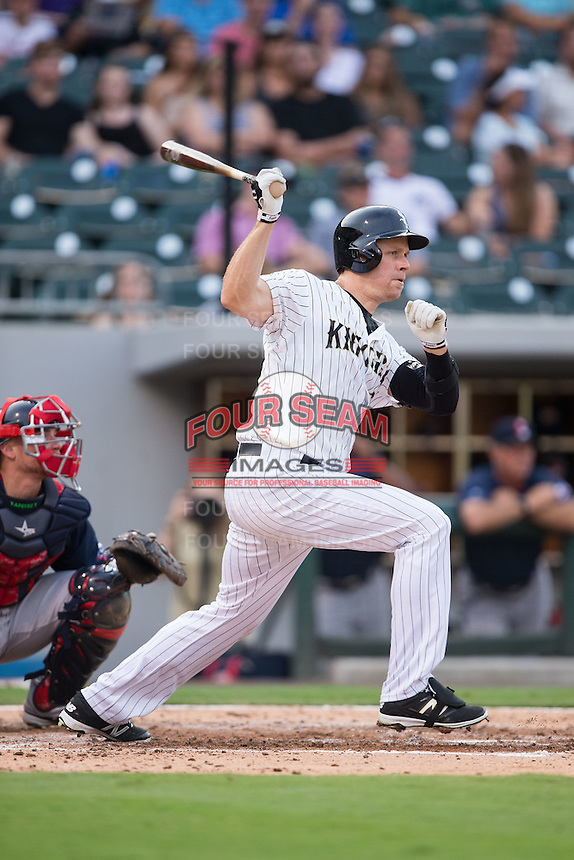 Justin Morneau (36) of the Charlotte Knights follows through on his swing against the Pawtucket Red Sox at BB&T BallPark on July 6, 2016 in Charlotte, North Carolina.  The Knights defeated the Red Sox 8-6.  (Brian Westerholt/Four Seam Images)