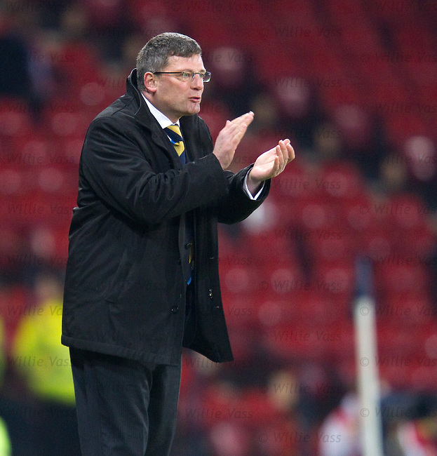 Craig Levein applauds his side as he shouts from the sidelines