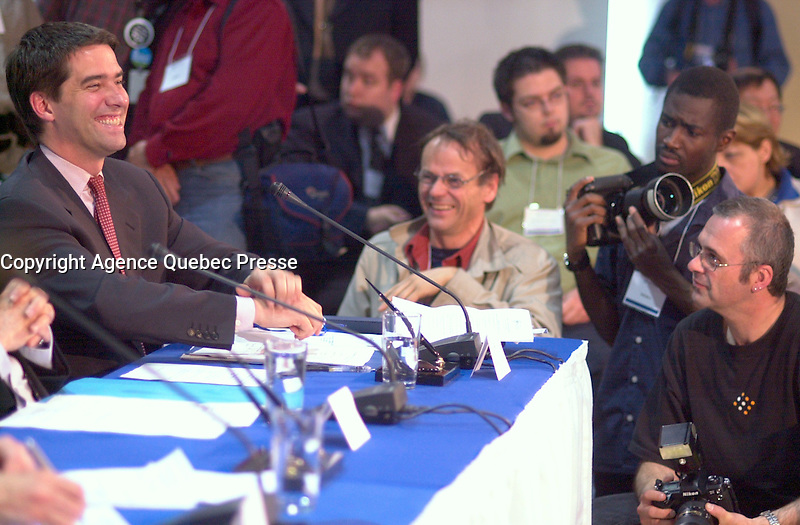 June 6 , 2002, Montreal, Quebec, Canada<br /> <br /> <br /> Andre Boisclair, Quebec Minister Municipal Affairs,<br /> Quebec Minister Environment joke with press photographers at  the closing  of the Montreal Summit<br />  (Le Sommet de Montr&Egrave;al), June 6, 2002<br /> <br /> <br />  <br /> Mandatory Credit: Photo by Pierre Roussel- Images Distribution. (&copy;) Copyright 2002 by Pierre Roussel <br /> ON SPEC<br /> NOTE l Nikon D-1 jpeg opened with Qimage icc profile, saved in Adobe 1998 RGB.