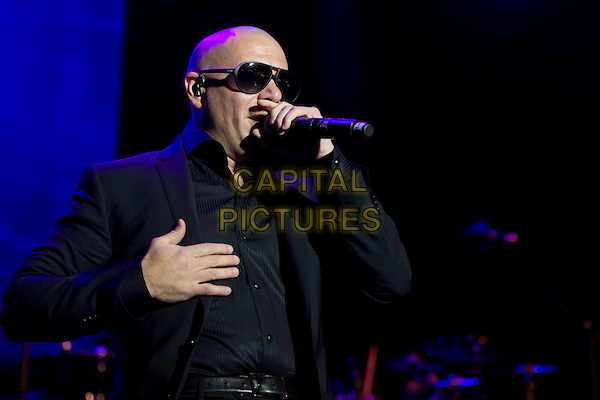 Pitbull (Armando Christian Perez).Concert in Krocus City Hall, Moscow, Russia..May 30th, 2012.on stage live gig performance performing music half length black suit sunglasses shades singing .CAP/PER/SB.©SB/PersonaStars/CapitalPictures
