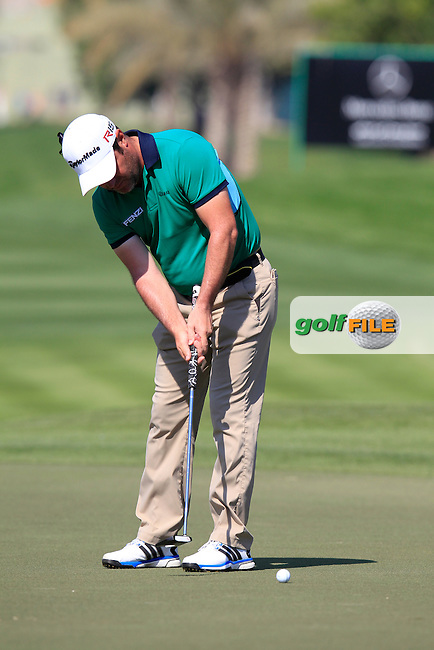 Marco CRESPI (ITA) putts on the 10th green during Thursday's Round 1 of the 2015 Omega Dubai Desert Classic held at the Emirates Golf Club, Dubai, UAE.: Picture Eoin Clarke, www.golffile.ie: 1/29/2015