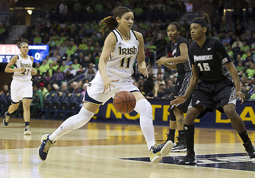 January 26, 2013:  Notre Dame forward Natalie Achonwa (11) drives to the basket as Providence forward Chanise Baldwin (15) defends during NCAA Basketball game action between the Notre Dame Fighting Irish and the Providence Friars at Purcell Pavilion at the Joyce Center in South Bend, Indiana.  Notre Dame defeated Providence 89-44.