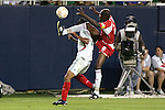 21 June 2007:  Guadeloupe's Alain Vertot (6) gets a leg up against Mexico's Alberto Medina (7).  Vertot was called for a foul on the play. The National Team of Mexico defeated Guadeloupe 1-0  in a CONCACAF Gold Cup Semifinal match at Soldier Field in Chicago, Illinois.